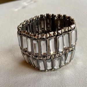 Glass and silver metal cuff bracelet.